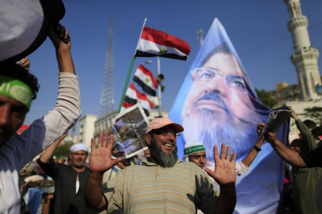 Supporters of ousted Egypt's Islamist President Mohammed Morsi chant slogans during a rally, in Nasser City, Cairo.