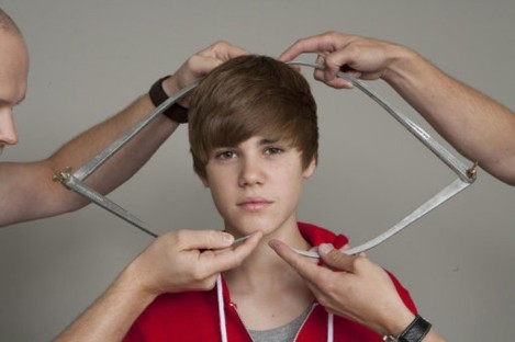 Justin Bieber is measured by Madame Tussauds' employees for a wax figure of the singer, to be unveiled in March 2011.