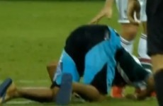 Fluminense fan invades the pitch to bow down and kiss Fred's feet