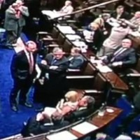 Male TD pulls female colleague into his lap - in the Dáil chamber