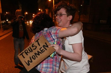 Members of the pro-choice camp celebrate the passing of the Protection of Life During Pregnancy Bill tonight outside Leinster House in the early hours of Friday morning.