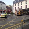 PICTURES: Man unaccounted for in Killarney after suspected gas explosion