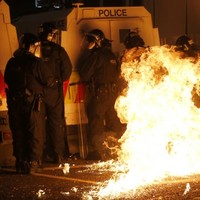 Gilmore condemns 'appalling' attacks on police in Belfast