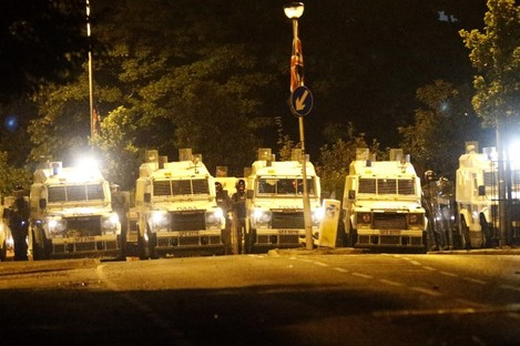 Riot police secure the Woodvale area close to Ardoyne in north Belfast.