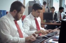 Luis Suarez diving and whining... in an office job