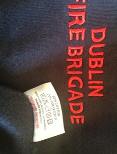 Label on Dublin Fire Brigade gear says 'Keep Away From Fire'