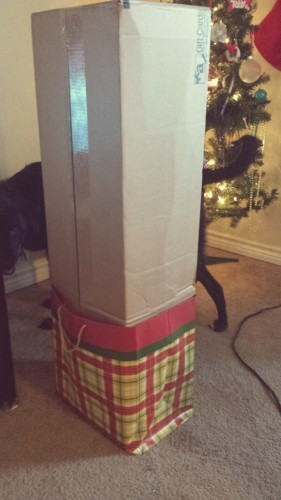 My husbands Christmas gift wrapping technique at its finest. - Imgur