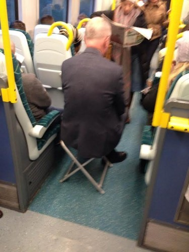 Fine This Man Has A Novel Way Of Ensuring He Has A Seat On The Train Beatyapartments Chair Design Images Beatyapartmentscom