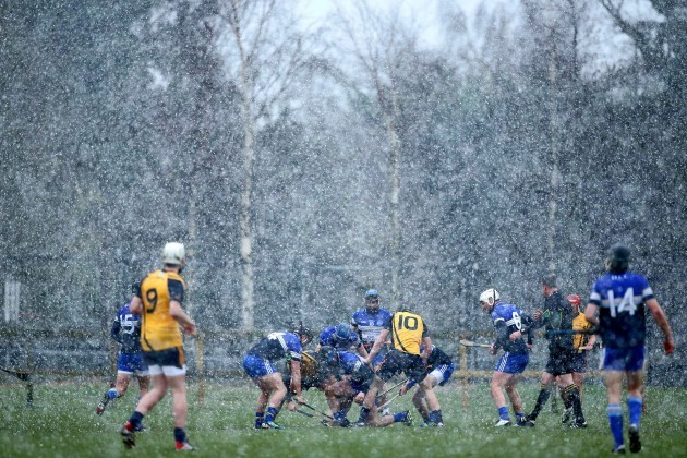 General view of the game between as snow comes down