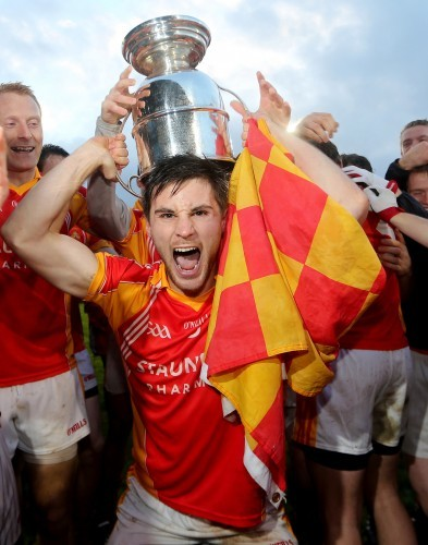 Donal Newcombe celebrates with the Moclair Cup
