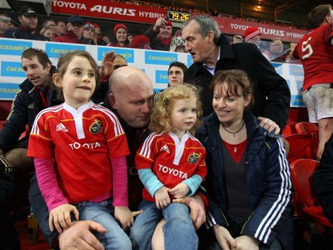 Munster's John Hayes at the end of the game with his daughters Sally and Roisin and wife Fiona