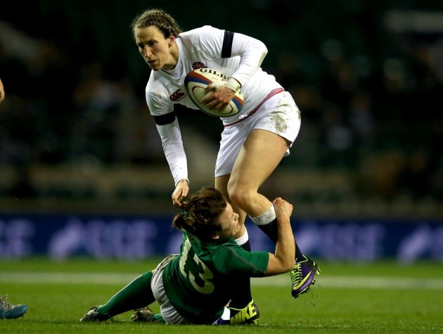 Katherine Merchant is tackled by Lynne Cantwell