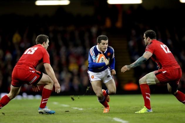 Brice Dulin tries to get between George North and Jamie Roberts