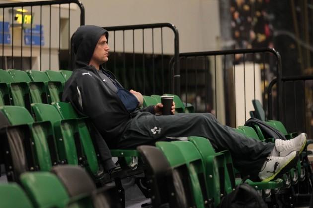 Irelands injured Jamie Heaslip looks on during the indoor training