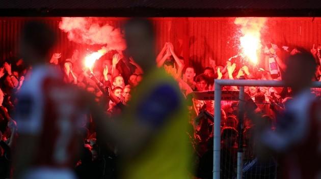 Dundalk supporters light flares