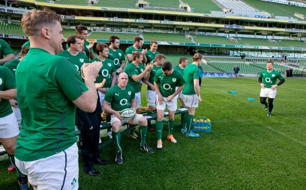 Brian O'Driscoll receives a round of applause from teammates as he arrives for the team photograph