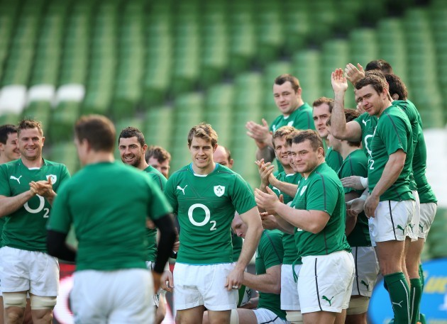 Brian O'Driscoll receives a round of applause from teammates as he arrives late for the team photograph