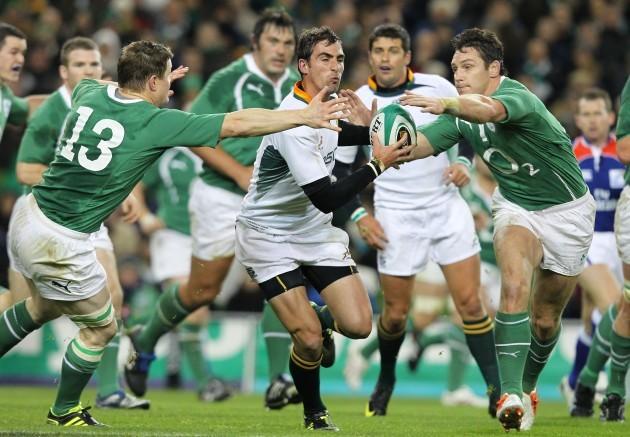 Ruan Pienaar tries to go past Brian O'Driscoll and David Wallace