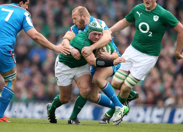 Rory Best is tackled by Leonardo Ghiraldini