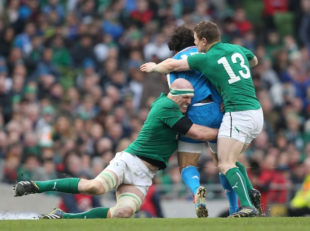 Paul O'Connell and Brian O'Driscoll tackle Luke McLean