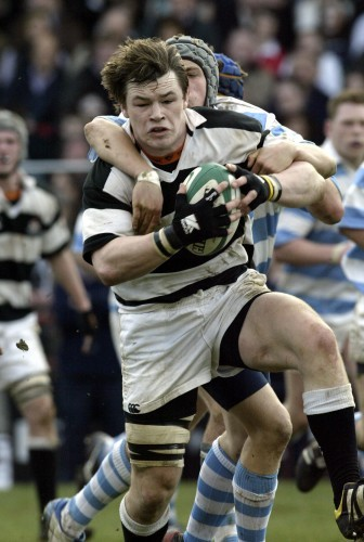 Cian Healy of Belvedere is tackled
