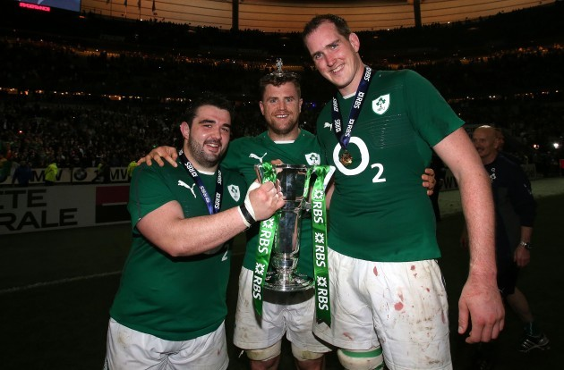 Martin Moore, Jamie Heaslip and Devin Toner celebrate with the trophy