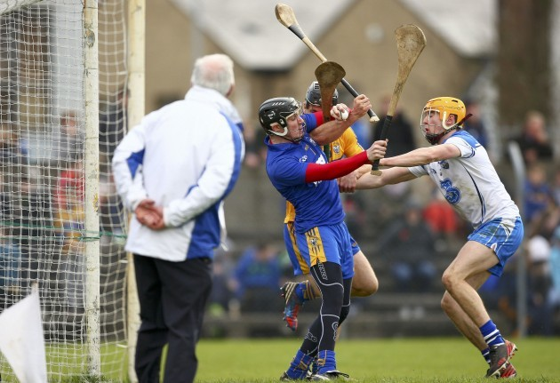 Donal Tuohy saves under pressure from Maurice Shanahan