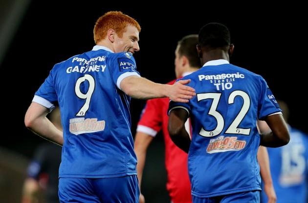 Rory Gaffney celebrates scoring a goal with Carel Tiofack