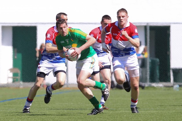 Wayne McKeon carries the ball while being chased by Gary O'Driscoll