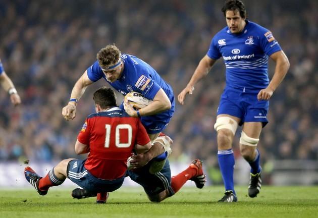 Ian Keatley and Damien Varley tackle Jamie Heaslip