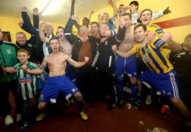 The Bray team celebrate in the dressing room after the game