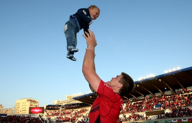Juan Smith with his son CJ after the game