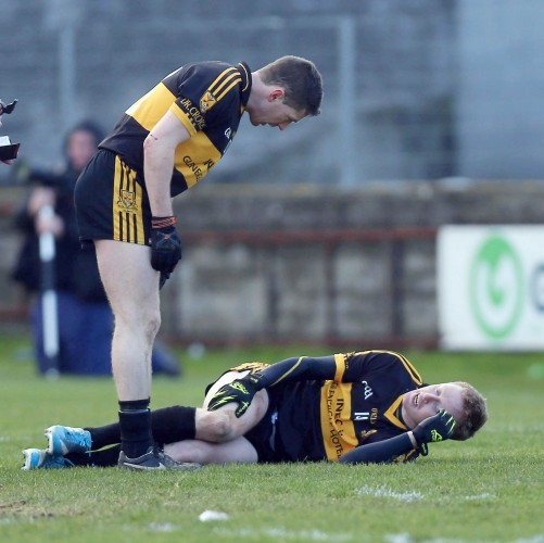 Kieran O'Leary checks on the injured Colm Cooper