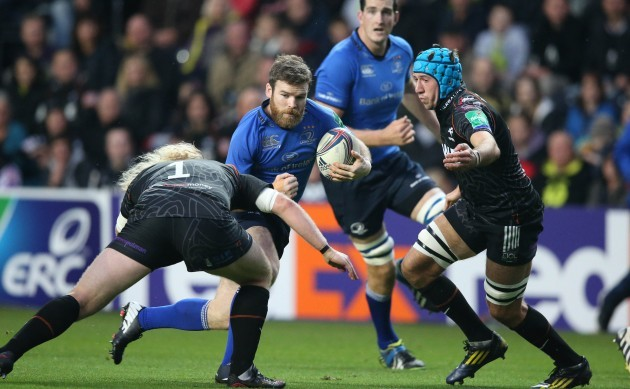 Gordon D'Arcy is tackled by Duncan Jones and Justin Tipuric