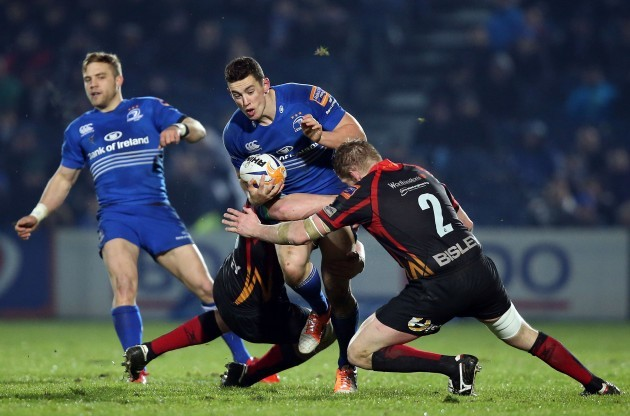 Noel Reid is wrapped up by the Dragons' defence