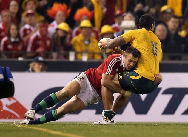 Australian Wallabies Joe Tomane  is tackled by British and Irish Lions's Tommy Bowe
