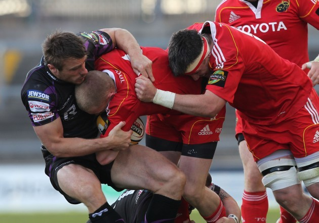 Tommy Bowe tackles Keith Earls supported by James Coughlan