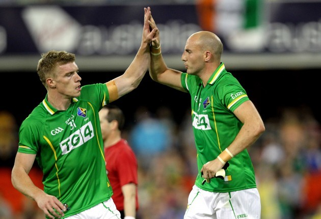 Tommy Walsh celebrates a score with Tadhg Kennelly