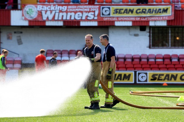 Local Fire crew are called in to help the watering of the 4g pitch at Solitude