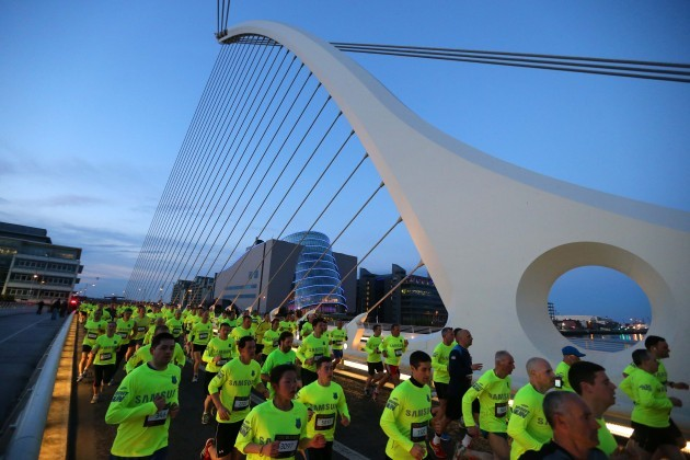 Competitors cross the Samuel Beckett Bridge