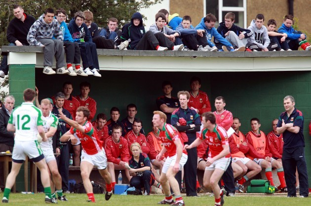 Supporters and the Mayo bench watch the action