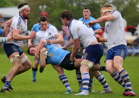 Conor Desmond and Willie Ryan tackle Jamie Glynn
