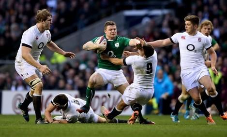 Brian O'Driscoll hands off Danny Care