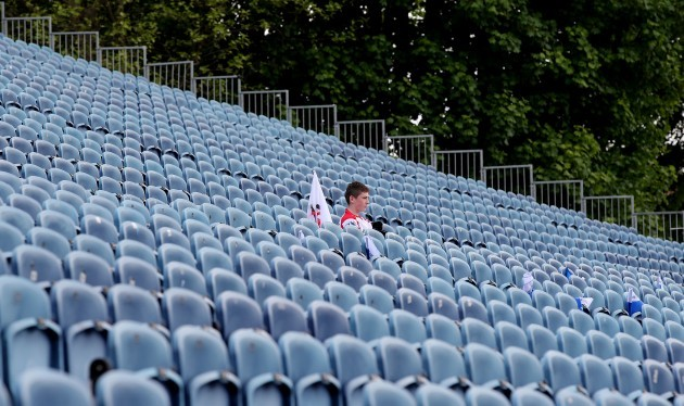 A lone Ulster fans takes his seat