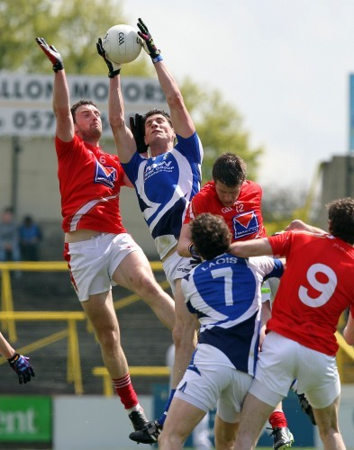 Derek Crilly and Brendan Quigley compete for a high ball