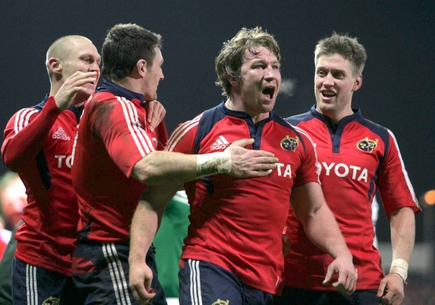 Jerry Flannery celebrates his try with David Wallace and Ronan O'Gara