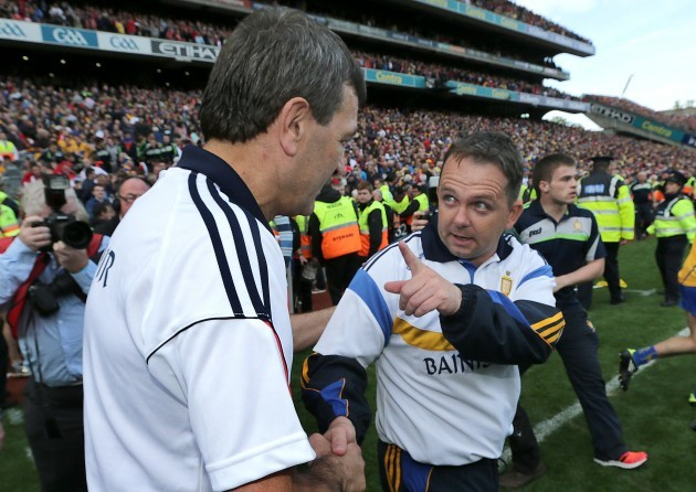 Jimmy Barry Murphy shakes hands with Davy Fitzgerald after the game