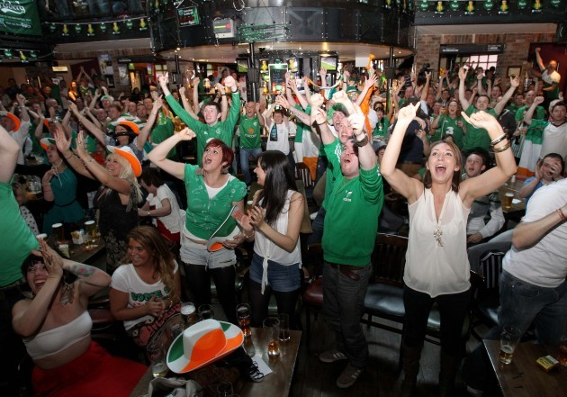 Irish fans celebrate Ireland's first goal of the game