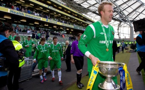 James Walsh celebrates with the trophy