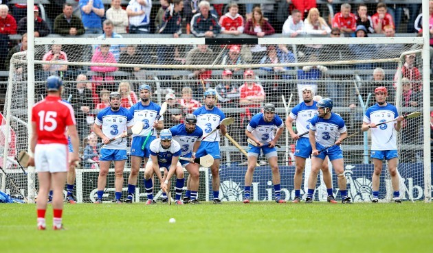 Waterford players defend a Patrick Horgan free
